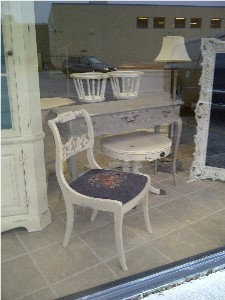 Chair and round table in front window